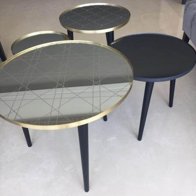 The Rebel tables. 60cm, or 45 cm,or  32cm. brass, copper, black steel or stainless steel frame in 2mm. arabesque, khaizaran or orient motif on mirror. round wood legs