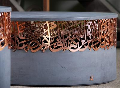 Concrete center table, with iron or bronze calligraphy.