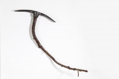 Evolution, 2019, Metal pickax & tree branch, 85 x 100 cm